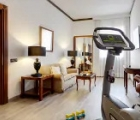 Melià Milano business suite living room with fitness  equipment
