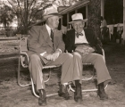 Ben Jones the trainer for Calumet Farm who with his son Jimmy would saddle two Triple Crown winners in Whirlaway and Citation sitting with Sunny Jim Fitzsimmons who saddled Gallant Fox and Omaha for two Triple Crown victories