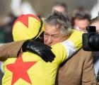 john-hales-and-harry-skelton-embrace-after-politologue-success-cheltanham-11-03-2020