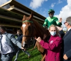Sottsass and Cristian Demuro are led in after winning the 2020 Prix de l'Arc de Triomphe, FRA Longchamp, 04 10